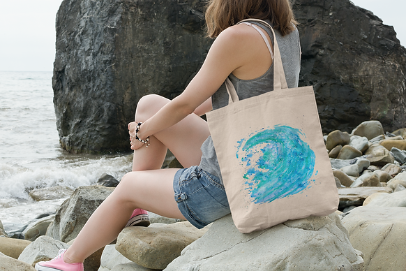 tote-bag-mockup-featuring-a-young-woman-sitting-on-a-rock-by-the-sea-109-el-4.png