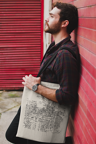 man-holding-a-tote-bag-mockup-while-lyin