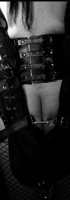 Leather corset and Leather Armbinder, session done in a BDSM party in Paris.