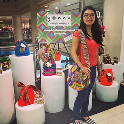 Yuki, from Japan, wearing proudly her new Yonna - Wayúu Handbag