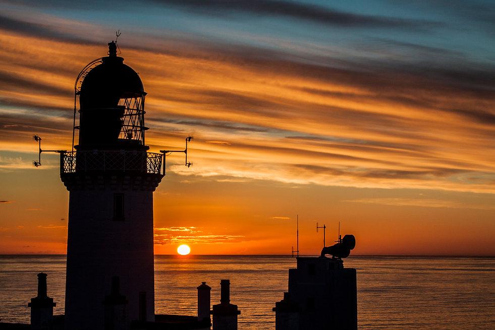 Sunset at Dunnet Head lighthouse, Scotland.