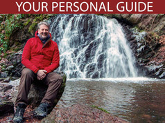 A North Coast Explorer Tour Guide at the Fairy Glen waterfalls on the Black Isle.