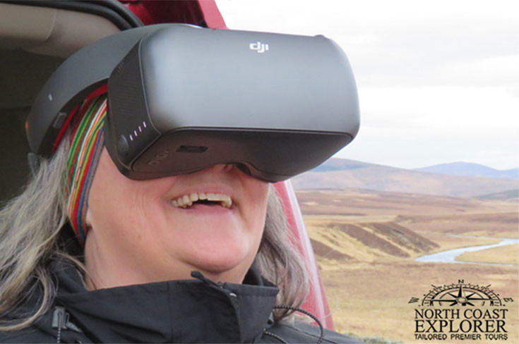 A hasd shot of a lady wearing DJI VR Goggles (racing edition)