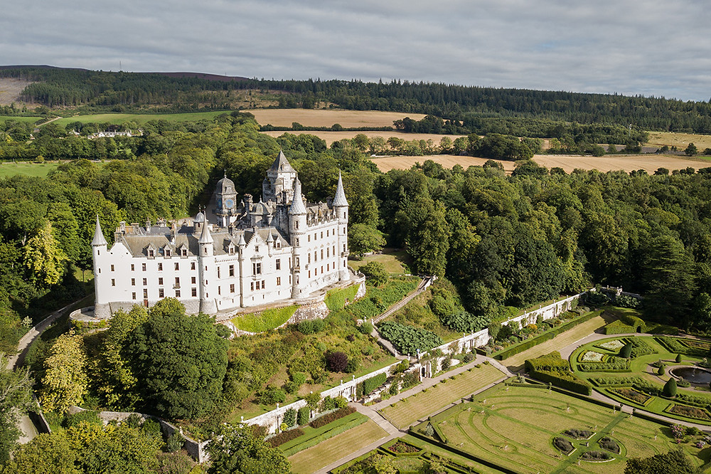 An aerial view of Dunrobin Castle in the sunshine.