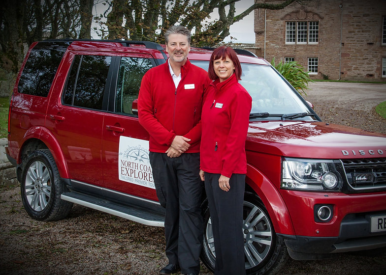 Robert & Sally-Ann James standing next to their Land Rover in front of The Castle of Mey