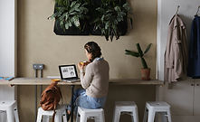 Woman-working-on-laptop-in-cafe.png