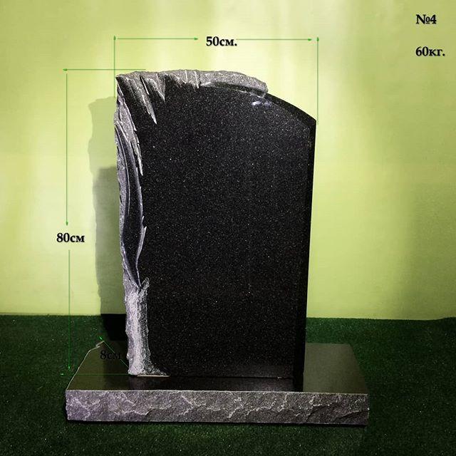 Granite candle. Cemetery monument. . . .