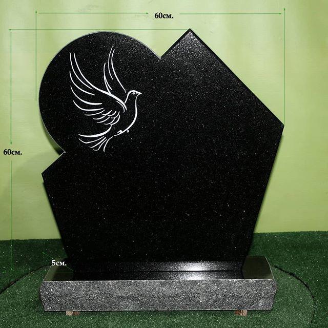 Black stone.  Cemetery monument. . .