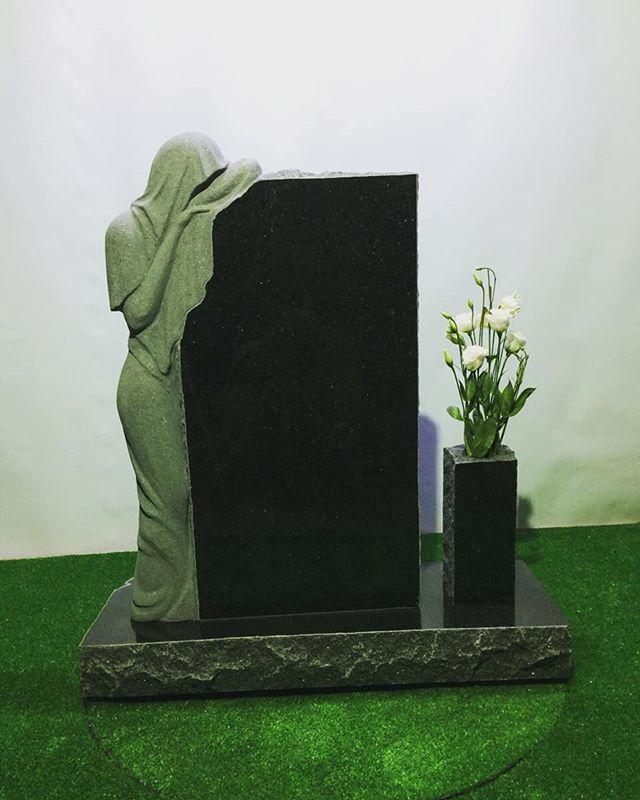 Cemetery monuments. Black granite. . . .