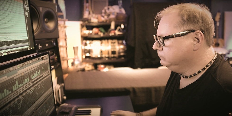 Darrell Nutt working editing drum samples at a computer.