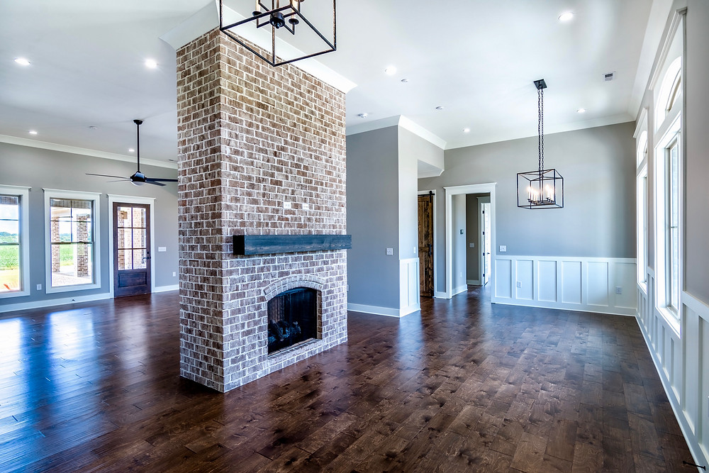 Dining and living room with wainscoting in this custom home in Muscle Shoals, AL
