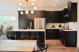 Chef's kitchen with dining room table seating 6