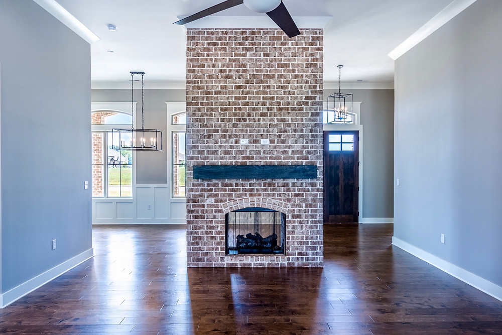 Stand alone fireplace in a custom home in Muscle Shoals, AL