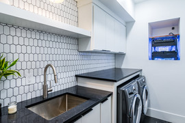 Laundry room with mudsink and full size washer and dryer