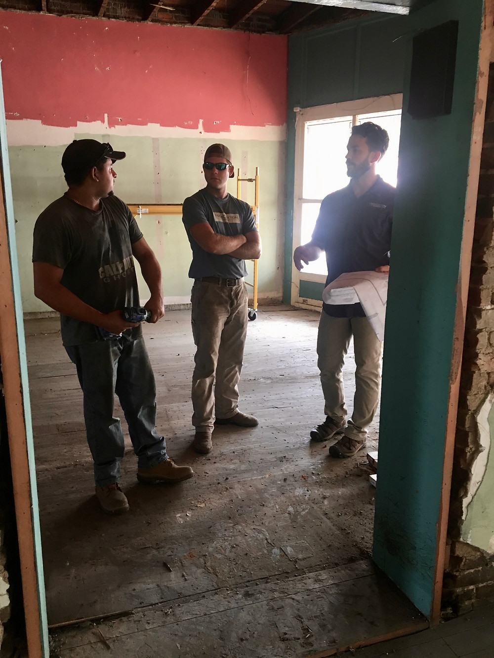 Will King, Adam Kelley, and Josue Rivas discuss the plans at the House of Vacuums