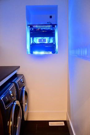 Network and AV rack in laundry room