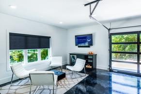 Garage flex space with mini fridge, HDTV and Sonos sound