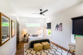 Queen size bed in guest bedroom