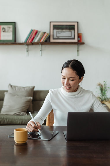 Young asian woman with an iPad at home