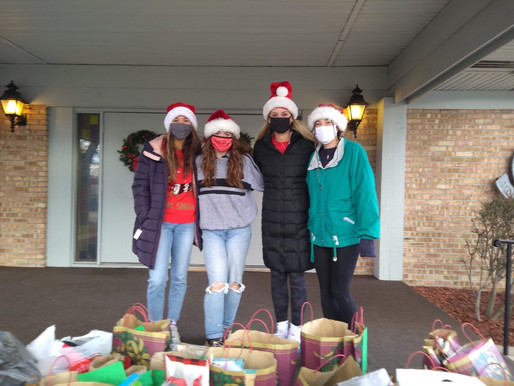 NHS Officers Deliver Toys for Teens around the Community