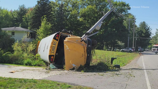 SUV Collides  into Spring Lake School Bus Causing a Roll-Over