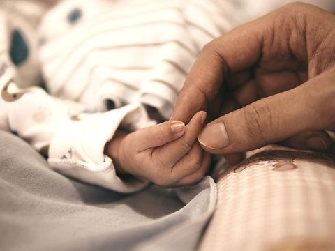 Holding baby's hand_edited.jpg