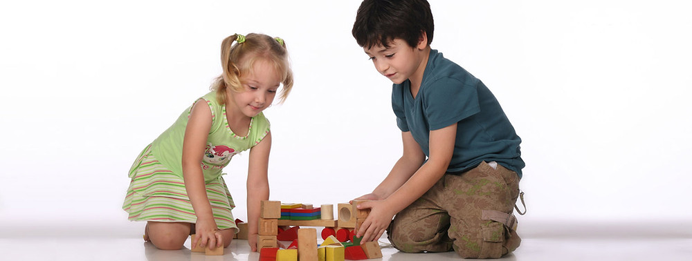 small children building with blocks