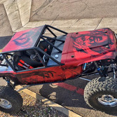 rock crawler style jeep with scary clown and demon wraps in red