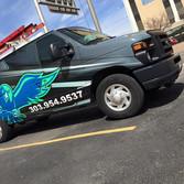 Restaurant Repair stickers on work and transport van