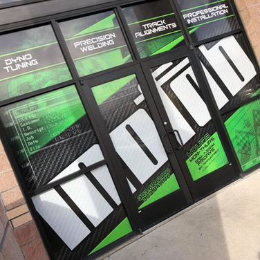 Perforated store front window graphics with see through film