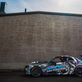 reflective custom wrap with company logos on the race car