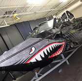 metal shark inspired boat wrap in gloss with gears and shark mouth Tige Boats