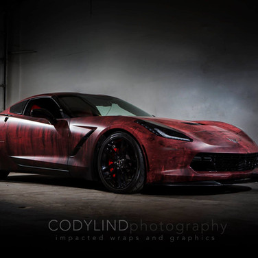 Red devil corvette with mean custom vinyl wrap
