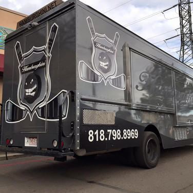 Hockey food truck with contact information on the vinyl color wrap