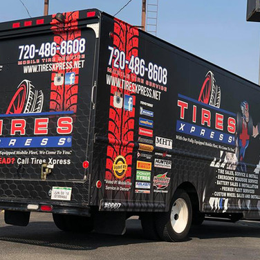 Matte black mobile tire truck graphics with tire brands