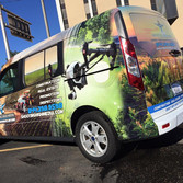 Photography vinyl wrap with services and contact information