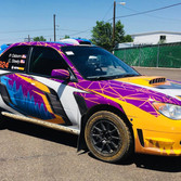 Rally car full design and custom wrap with trees and bright colors