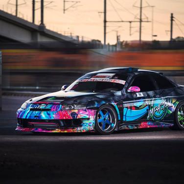Race drift vehicle with graffiti automitive style wraps