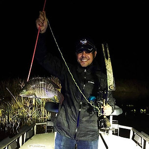 Took my buddy bowfishing for his first t