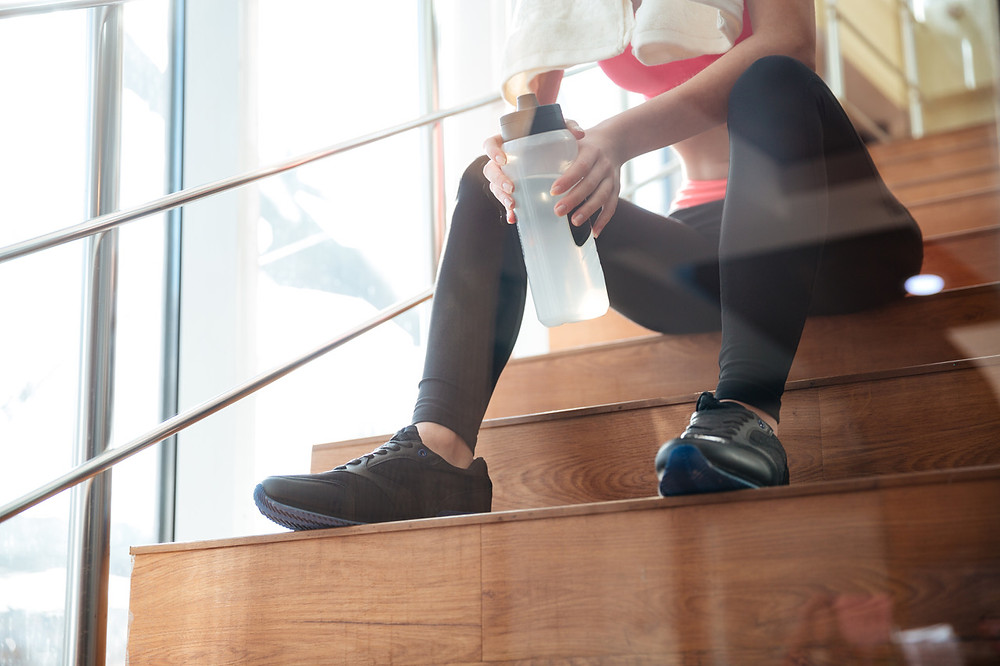 Resting on the stairs after a workout