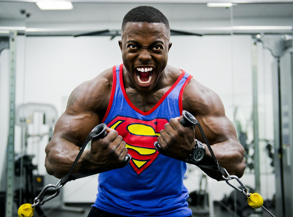 Superman body builder looking intimidating at the gym