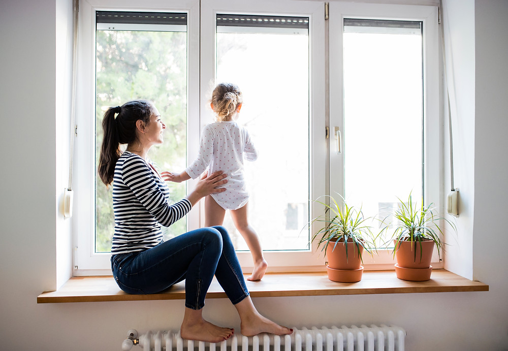 Mom with child by window
