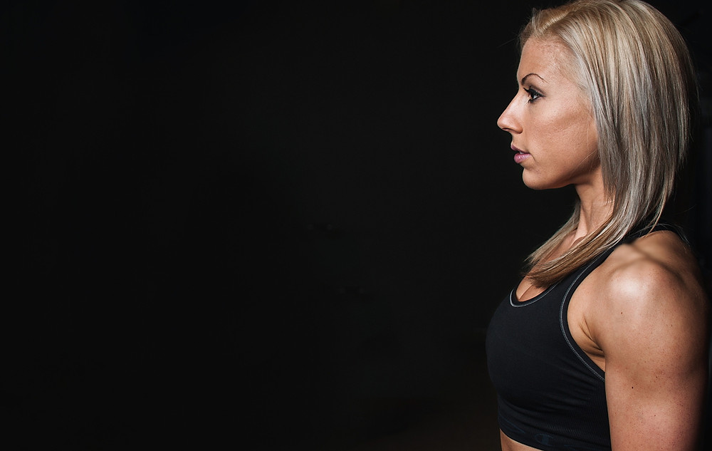 Profile of woman ready to exercise