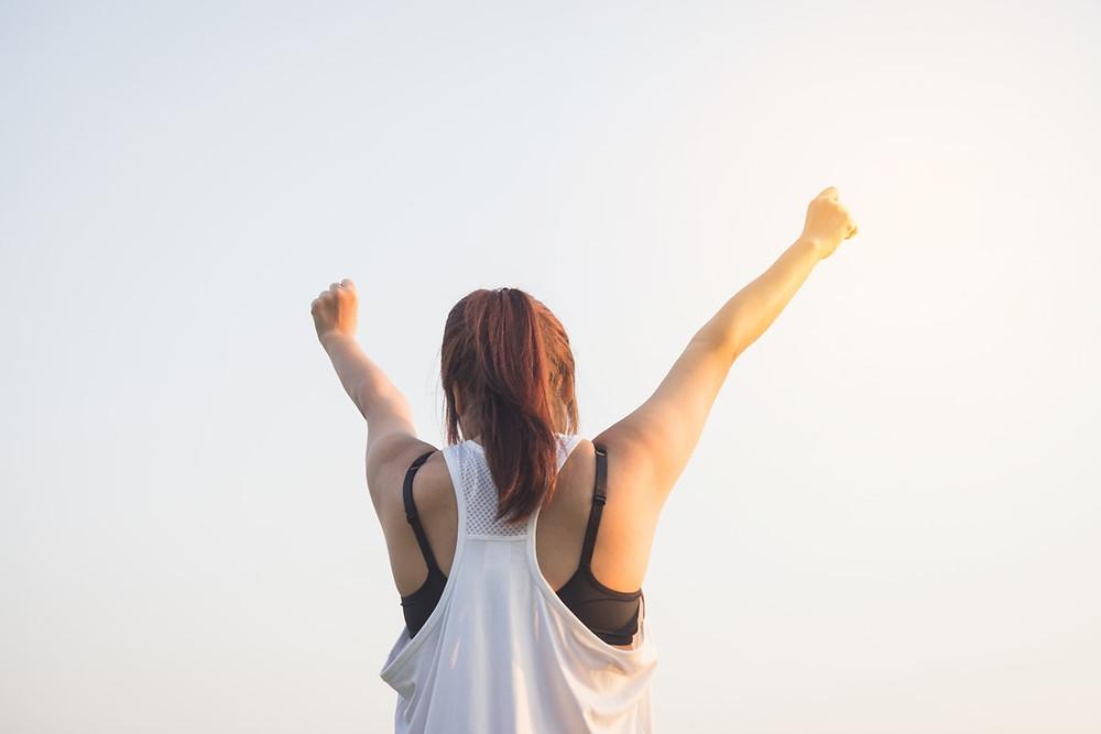 Triumphant Mom reaching to sky
