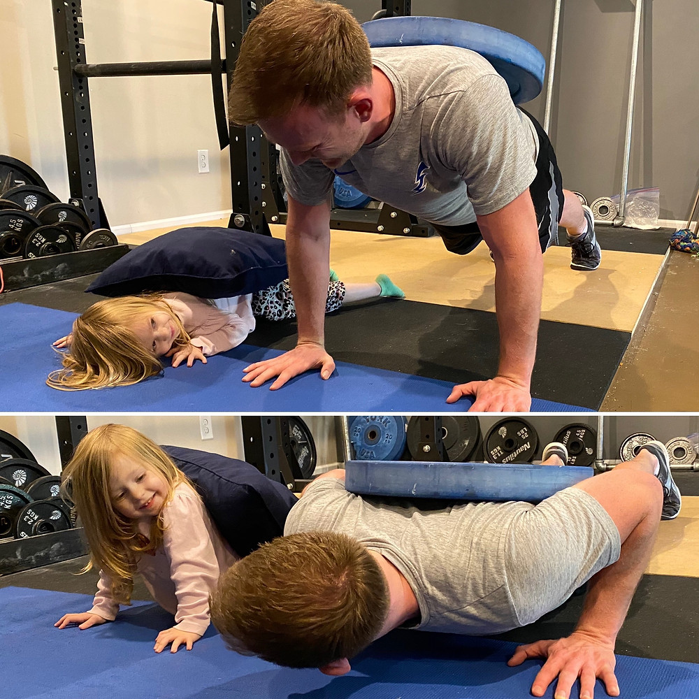 Personal trainer and little girl exercising together