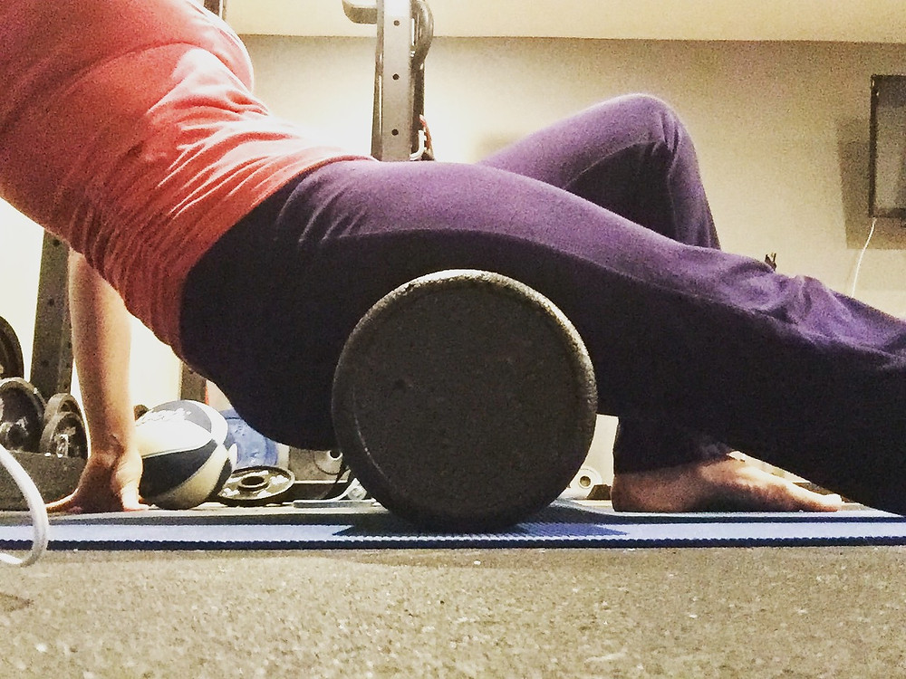 Woman using foam roller