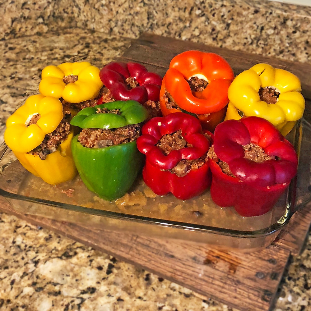 Colorful stuffed peppers in a casserole dish