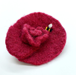 Felted upcycled wool brooch.