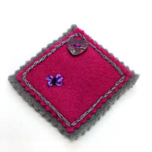 Hand made felt brooch with embellishements