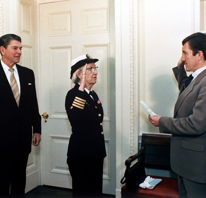 Hopper alongside President Ronald Regan being promoted to the rank of commodore in 1983